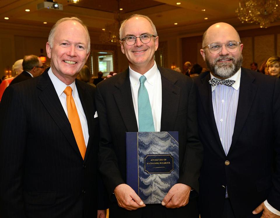 Nathaniel Philbrick (center) with New England Historic Genealog-ical Society's Bill Griffeth (left) and Brenton Simons.