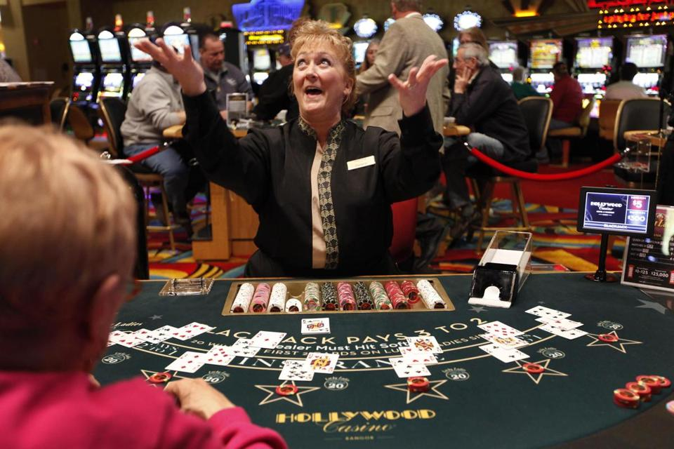 The blackjack dealer announced a winning hand at Hollywood Casino in Bangor, where the early crowds (below) have since gestures after dealing a winning hand at Hollywood Slots, Friday, March 16, 2012