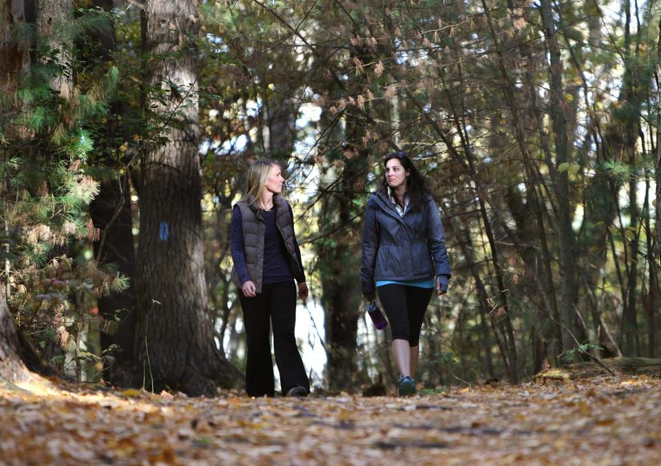 Abbie Hausermann (left) and client Lara Andrews at Wilson Mountain Reservation in Dedham.