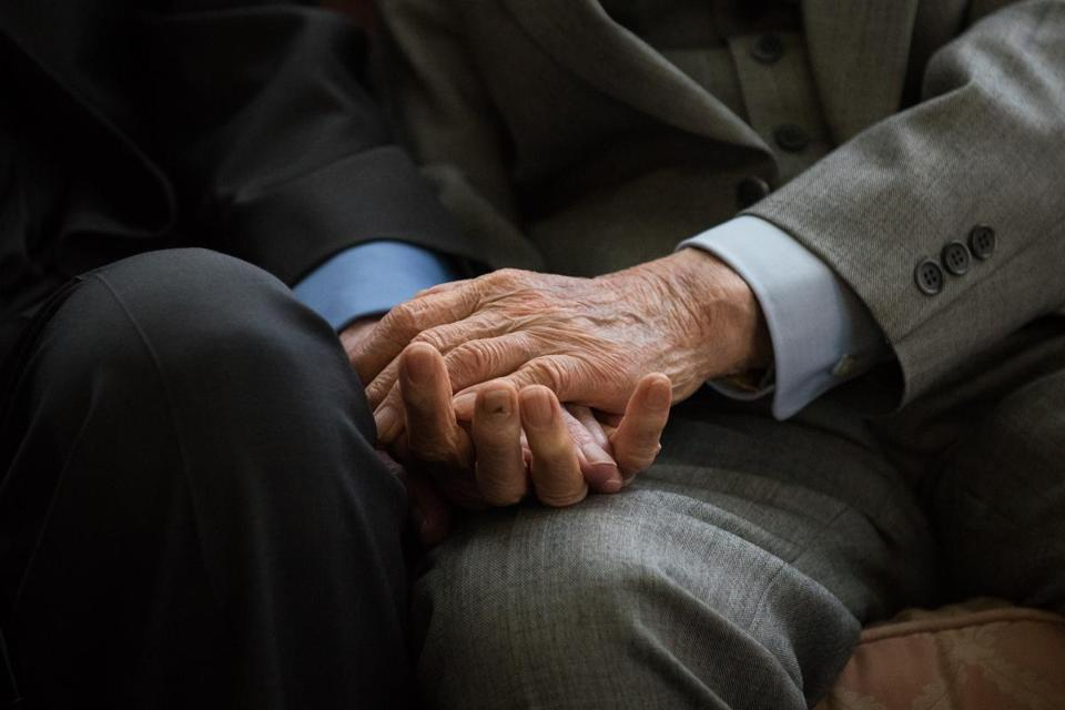"World War II veterans, British former army captain Harold Atcherley (left), 96, and Japanese former army engineer Mikio Kinoshita (right), 94, held hands as they attended a reception in their honor in London in June. While held as a prisoner of war by the Imperial Japanese Army in 1943, Atcherley was forced to work on the infamous Burma-Thailand ""death railway,"" a Japanese wartime project that cost the lives of an estimated 120,000 people. Kinoshita served as a Japanese army engineer, working on the same railway line."