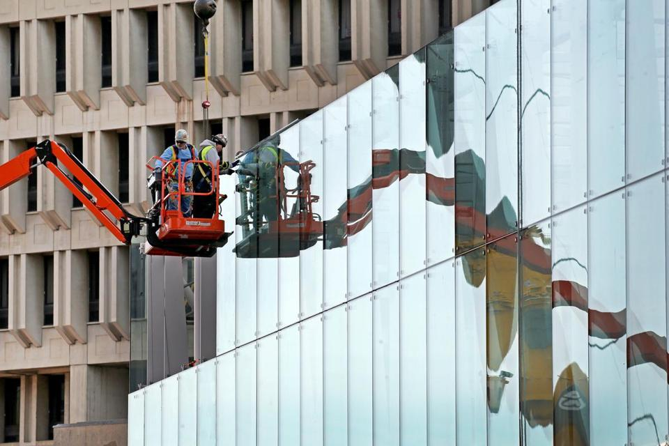 Workers have been reinstalling glass panels at the Government Center T stop, next to City Hall, after a sealant on some of the windows failed.