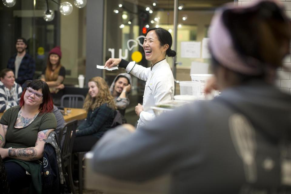 Chang leads a staff meeting at  the south end flour and leaves the company's new allston production kitchen on her preferred mode of transportation.