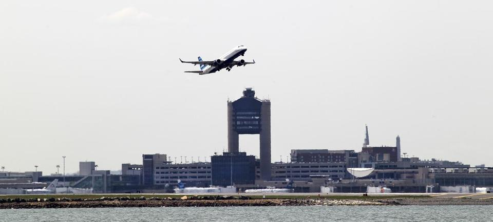 Winthrop, MA--529/2014--Plane take-offs from Logan Airport are viewed from Deer Island. Scenes in Winthrop are photographed, on Thursday, May 29, 2014. Photos by Pat Greenhouse/Globe Staff Topic: 060814location Reporter: XXX