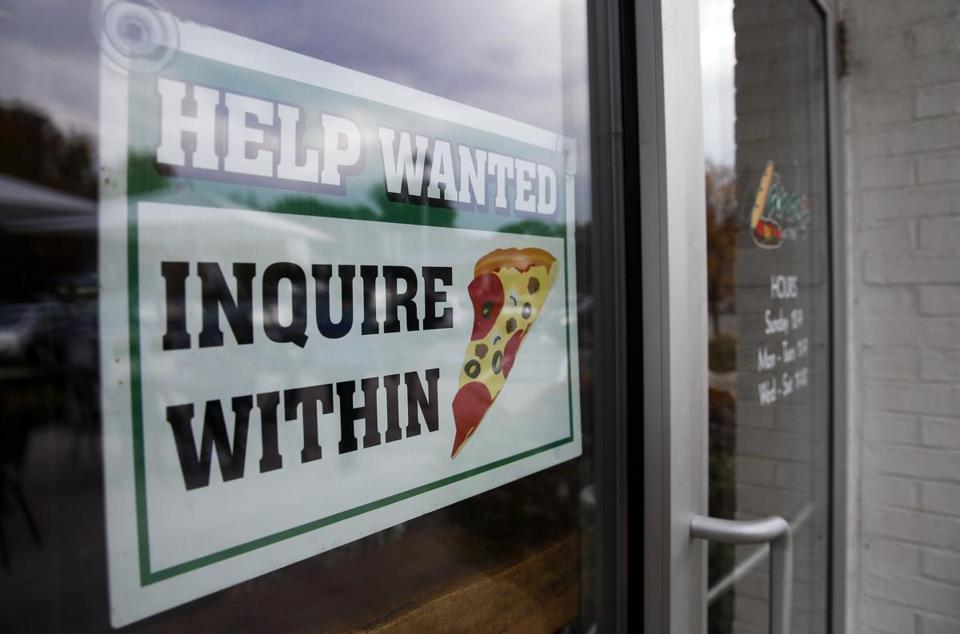 A help wanted sign hung in the window of Lando's restaurant in Acton, Massachusetts, last October.