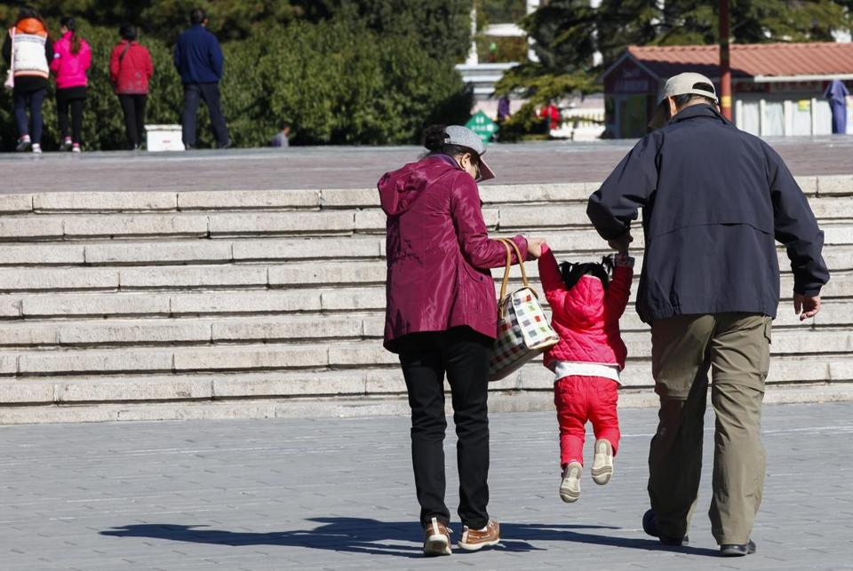 Chinese grandparents took their grandchild to a public park in Beijing. The Chinese government announced Thursday it would end its one-child policy and allow couples to have two children.