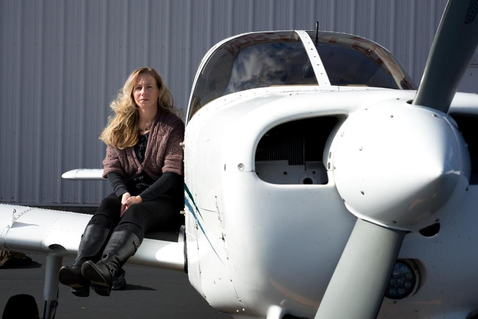 Oct. 30, 2015 - Alexa SInger (cq) poses at Beverly Airport in Danvers, Mass. Singer, who recently became head of the aviation program at North Shore Community College, is posing near aircraft used in the school's program.