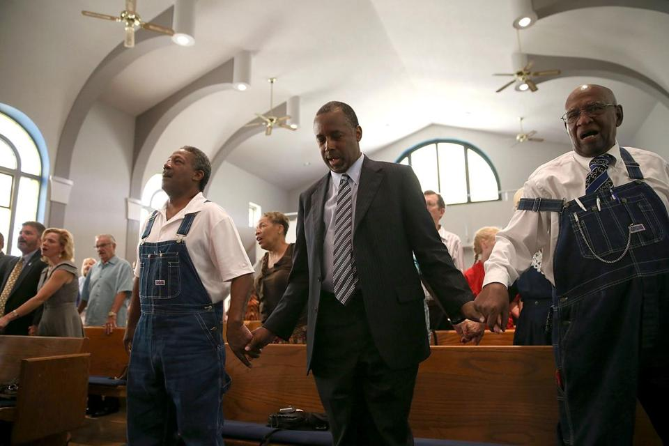 Republican candidate Ben Carson prayed during church services in Des Moines, Iowa.