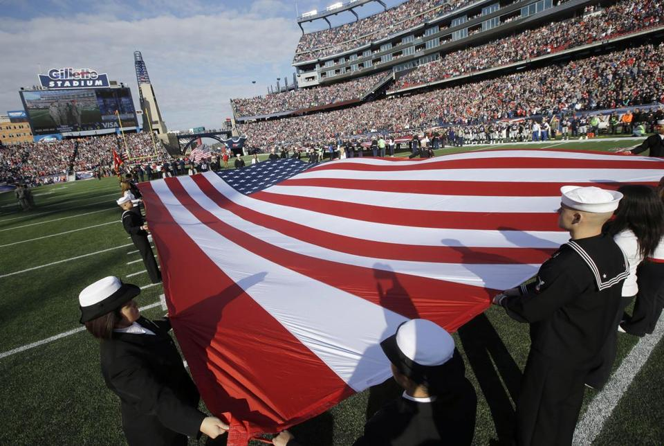 Members of the US Navy joined other members of the military displaying flags on the field of Gillette Stadium before a game between the Patriots and the Lions last November.