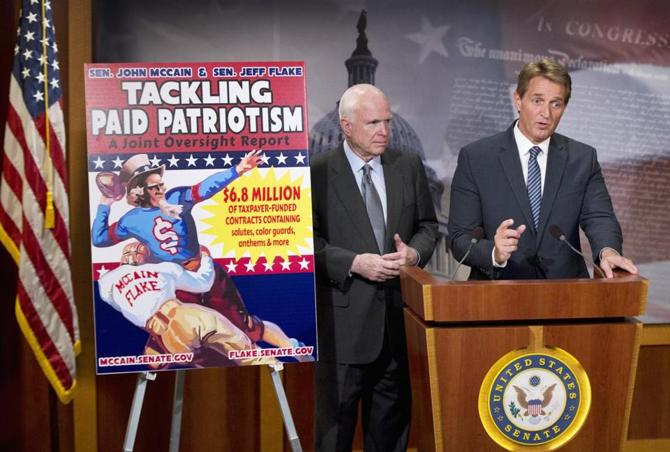 Senators John McCain and Jeff Flake, both Arizona Republicans, spoke to reporters about paid patriotism on Wednesday.