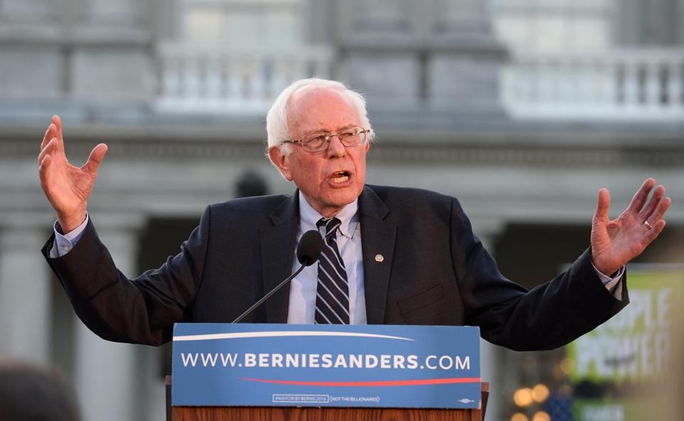 Democratic Presidential hopeful Bernie Sanders talked with the crowd gathered outside the New Hampshire State House after he filed for the state ballot.