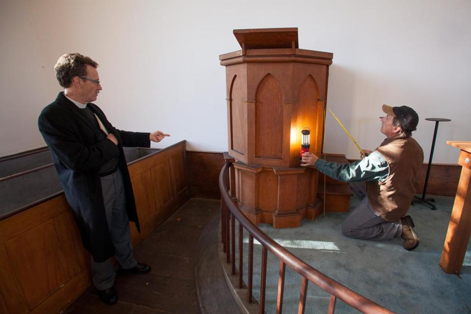 The Reverend Stephen T. Ayres of Old North Church (left) and restoration expert Steve Marshall inspected the pulpit at St. Paul's Church.
