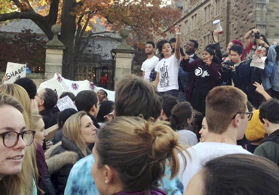 Yale students and their supporters marched across campus Monday to demonstrate against what they see as racial insensitivity at the Ivy League school.