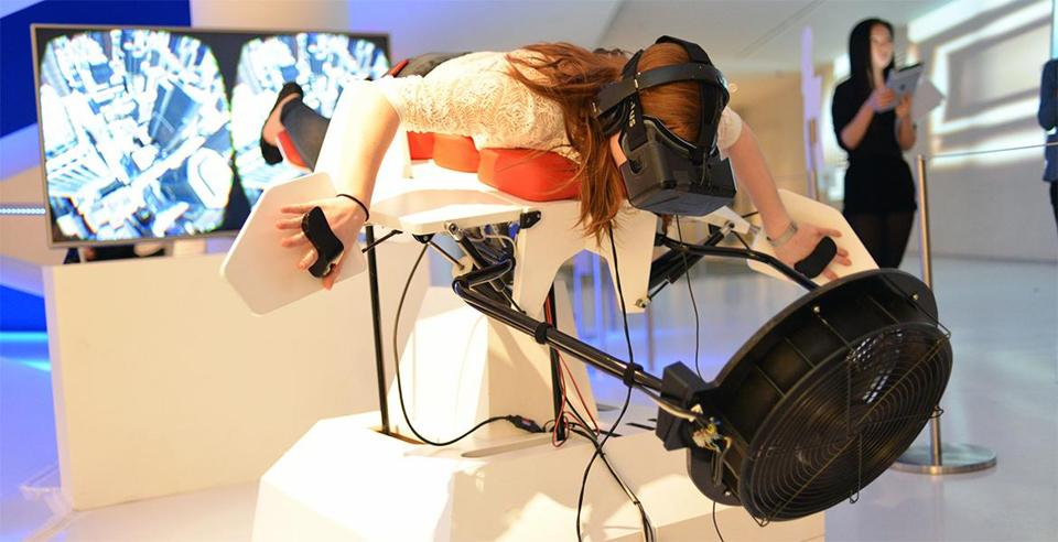 12birdly -- A user tries out Birdly, a 3-D exhibit that lets people experience what it's like to be a bird soaring through New York City. (swissnex Boston)