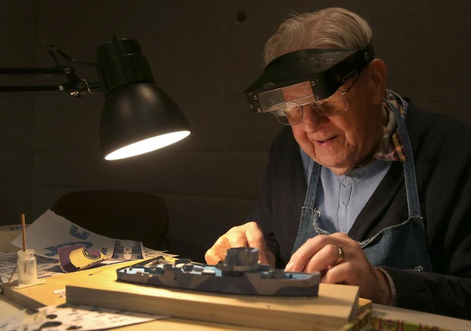 Frank Clements, 86, who has been making models since he was 10, worked on a cardboard model of a vessel.
