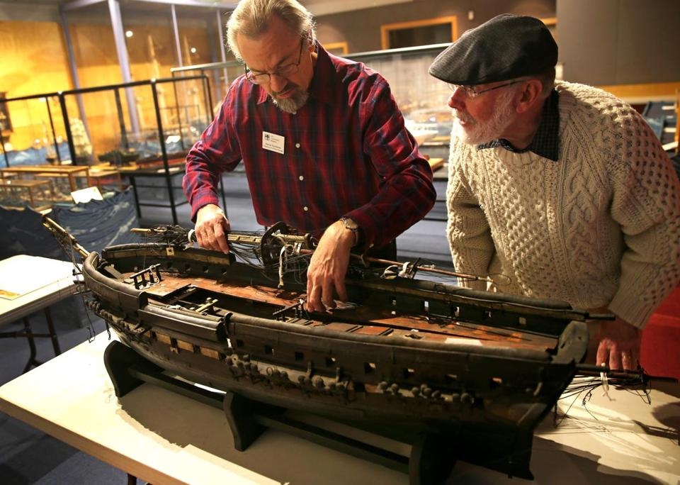The USS Constitution Museum's Harrie Slootbeek (left) and artist Ryan Cooper looked over an 1870's model of the USS Constitution.