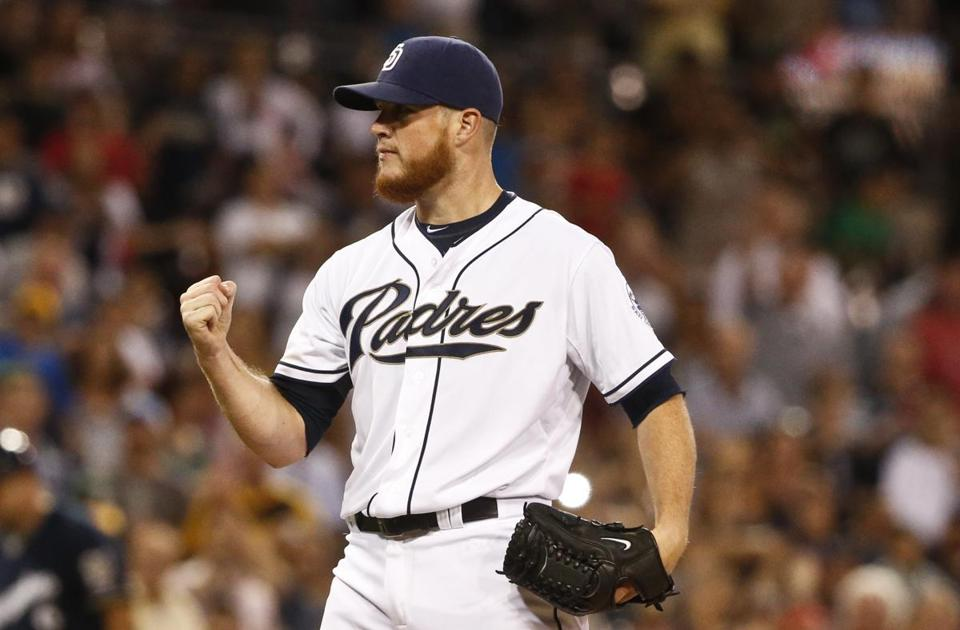 San Diego Padres closer Craig Kimbrel pumps his fist after striking out the final batter against the Milwaukee Brewers in the ninth inning of a baseball game won 3-1 by the Padres Thursday, Oct. 1, 2015, in San Diego. (AP Photo/Lenny Ignelzi)