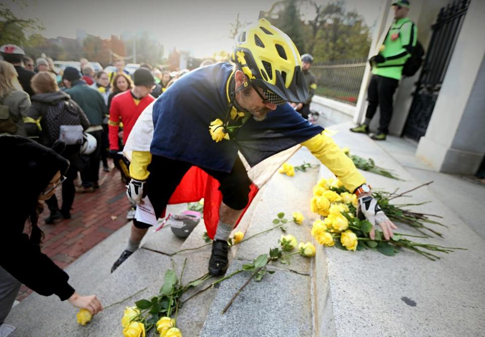 Cyclist Matthew J. Donovan placed flowers on the steps of the State House.