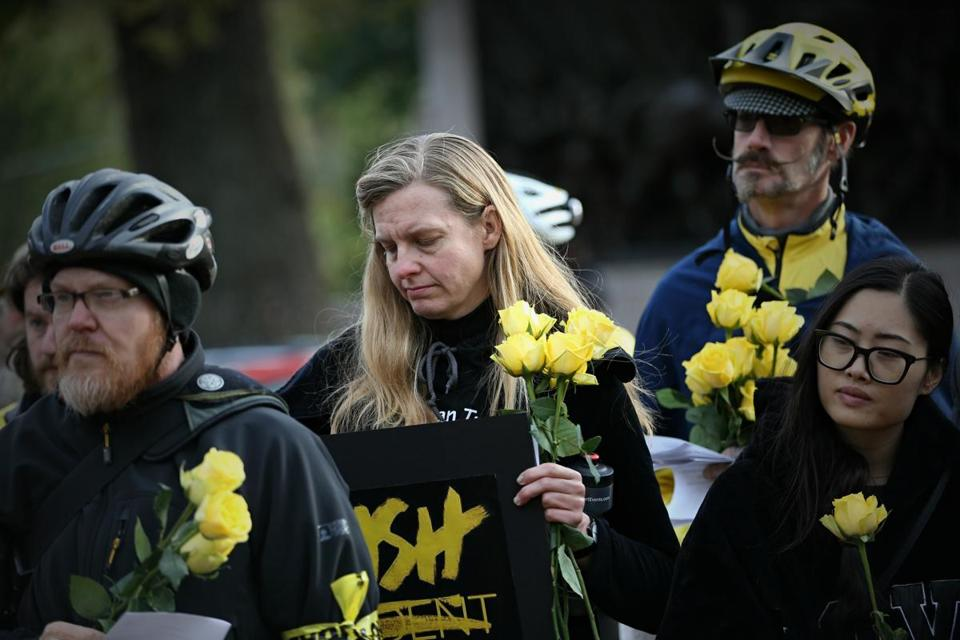 Participants at the rally on Sunday held flowers in remembrance of those killed in car crashes.