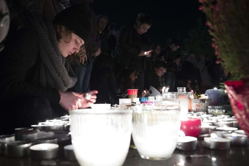 People lit candles Sunday at a makeshift memorial at the Place de la Republique in tribute to the victims of Friday's attacks in Paris.
