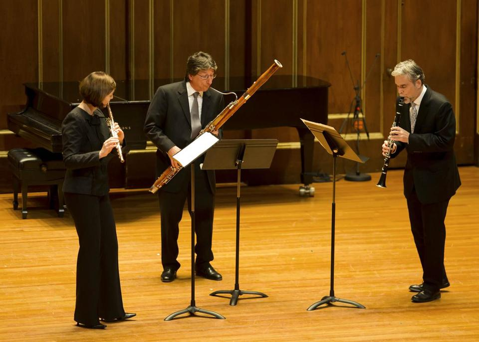 From left: Elizabeth Rowe, William Hudgins, and Richard Svoboda performed Piston's Three Pieces for flute, clarinet, and bassoon.