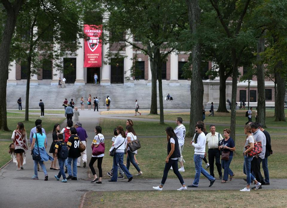 CAMBRIDGE MA - 9/10/2015: A tour group at Harvard University....Harvard issues new rules for tourists as people flock to Harvard Yard asking visitors to respect the privacy of it's students. (David L Ryan/Globe Staff Photo) SECTION: METRO TOPIC 11harvardyard