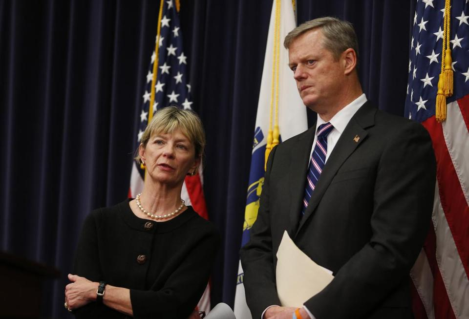 Health and Human Services Secretary Marylou Sudders (left) and Governor Charlie Baker conferred during Tuesday's press conference.