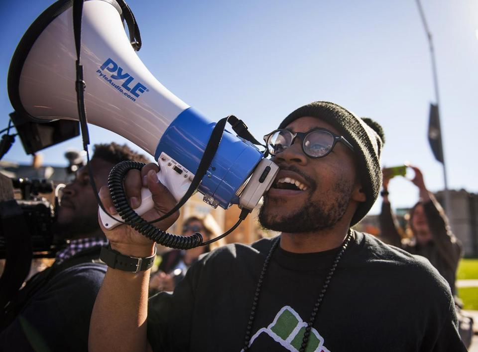 "Activist and graduate student Jonathan Butler spoke into a megaphone while walking in a ""We Are Not Afraid"" march on Friday on the University of Missouri campus."