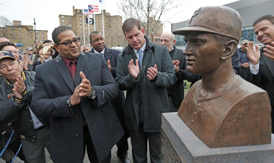 Luis Clemente, (second from left) son of Roberto Clemente, attended the unveiling ceremony in the South End.