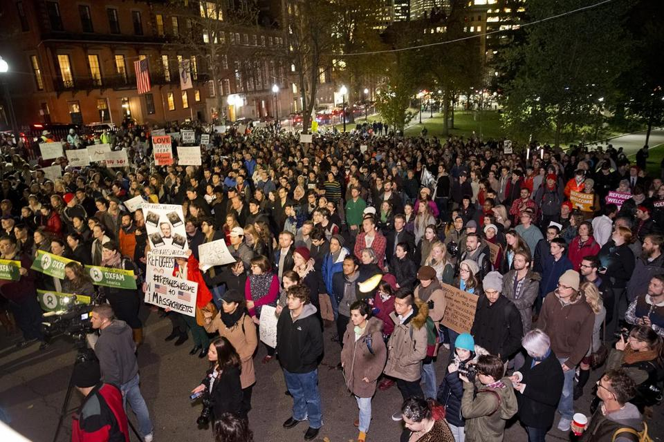 More than 1,000 people protested Gov. Charlie Baker's position against allowing Syrian refugees into the state.