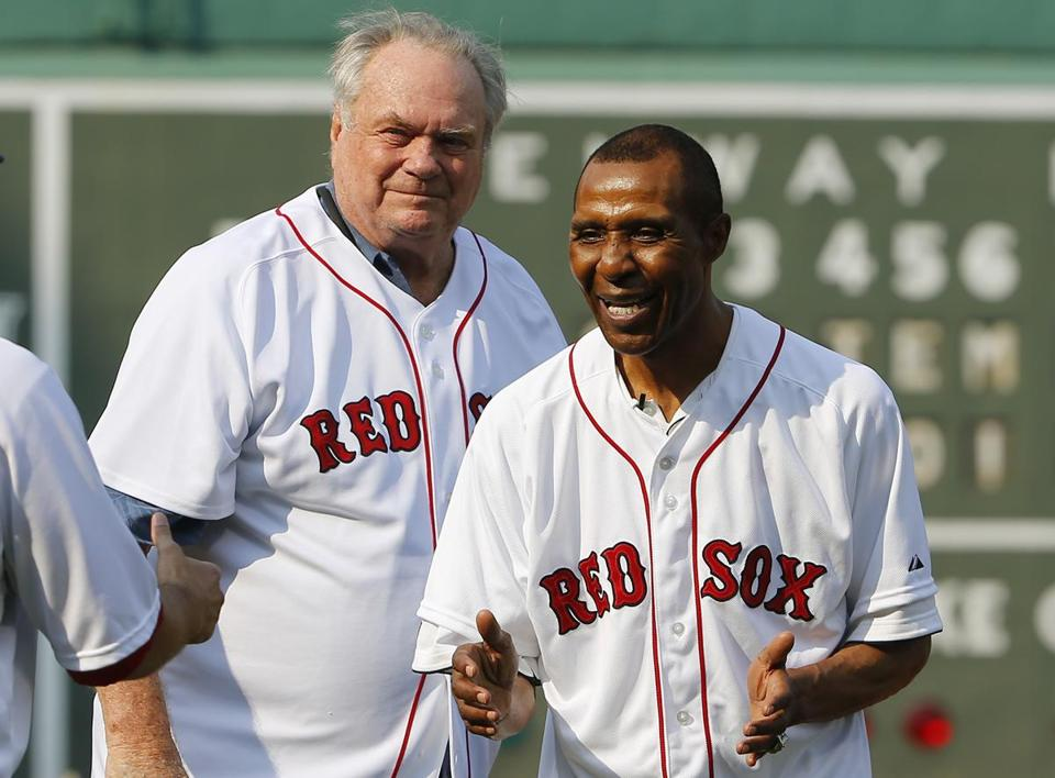 Celtics great Jo Jo White (right), with former Celtic Tommy Heinsohn before throwing out the first pitch at a Red Sox game in September.