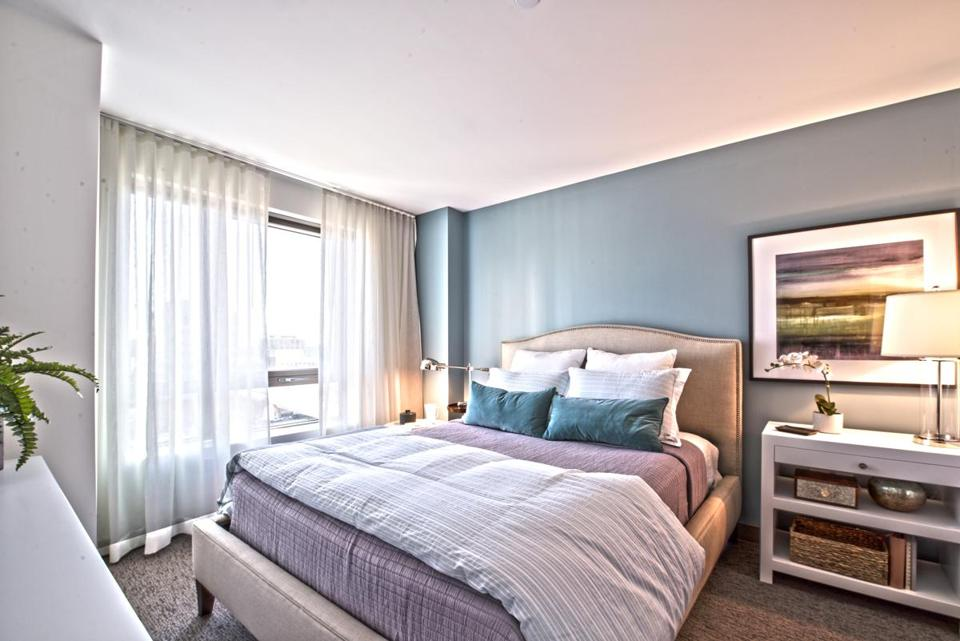 A bedroom in the model apartment at One Greenway, a new upscale development on Kneeland Street.