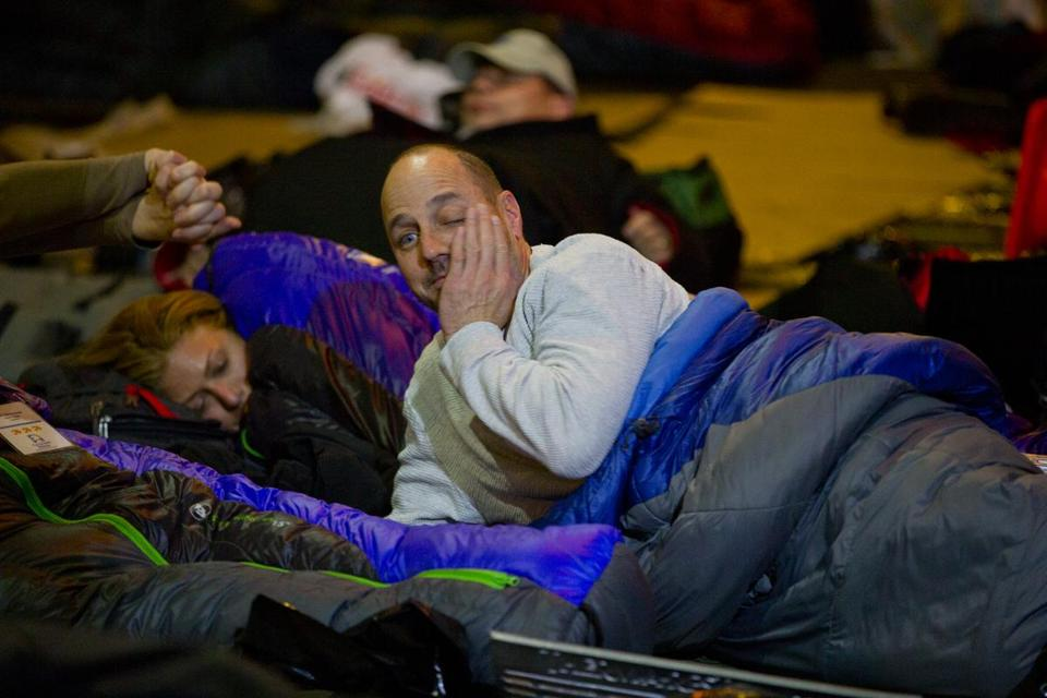 A groggy Brian Cashman spent a restless night of sleep on a New York sidewalk, in the interest of charity.