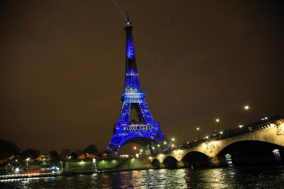"An artwork entitled ""One Heart One Tree"" by artist Naziha Mestaoui is displayed on the Eiffel tower ahead of the 2015 Paris Climate Conference."