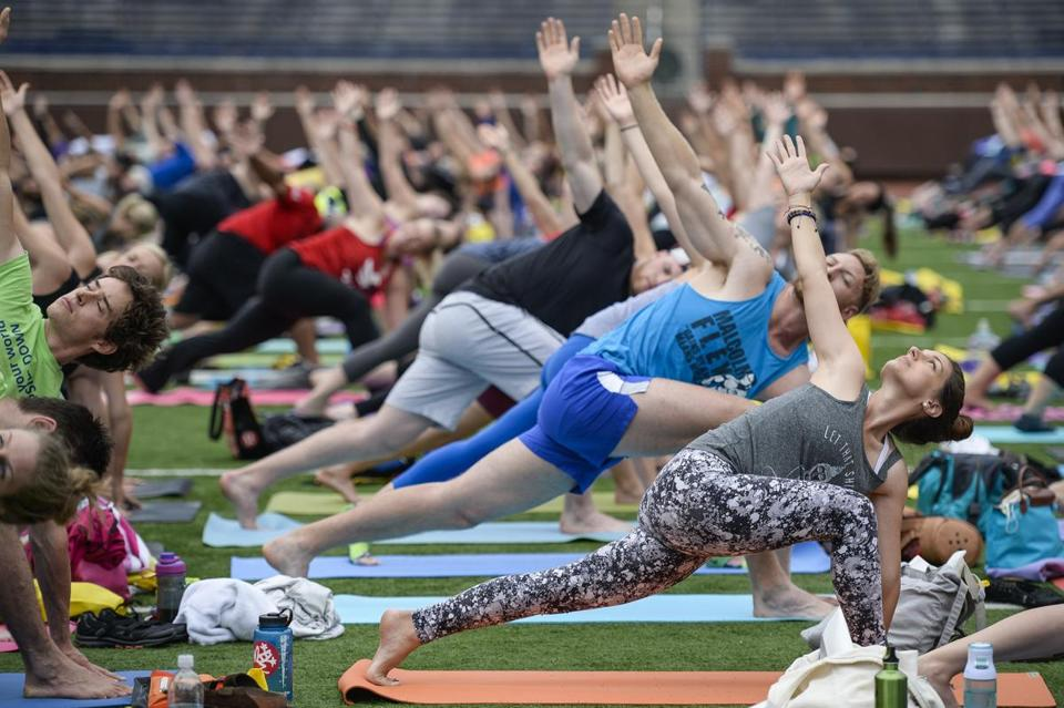 More than 1,000 people participated in a yoga session at the Michigan Stadium in Ann Arbor.