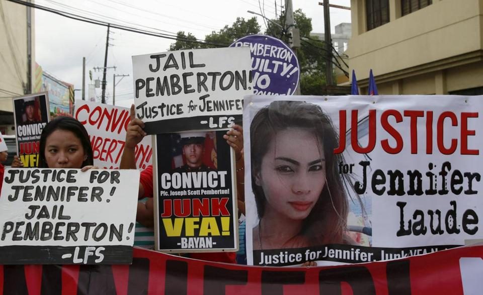 Protesters displayed placards outside a court in Olongapo city.