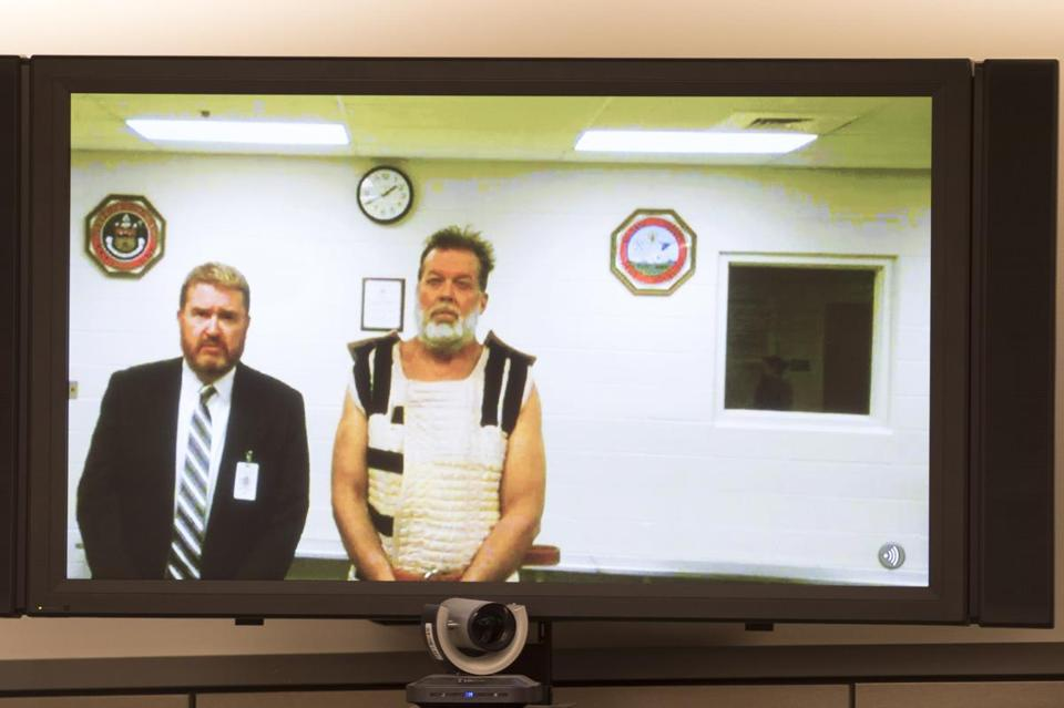 Robert L. Dear Jr., who appeared via video link, is accused of fatally shooting three people.