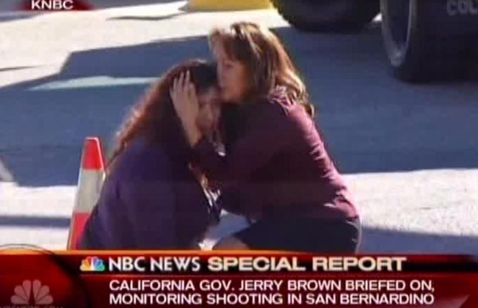 Two women comforted each other near the scene of Wednesday's shooting in San Bernardino, Calif.