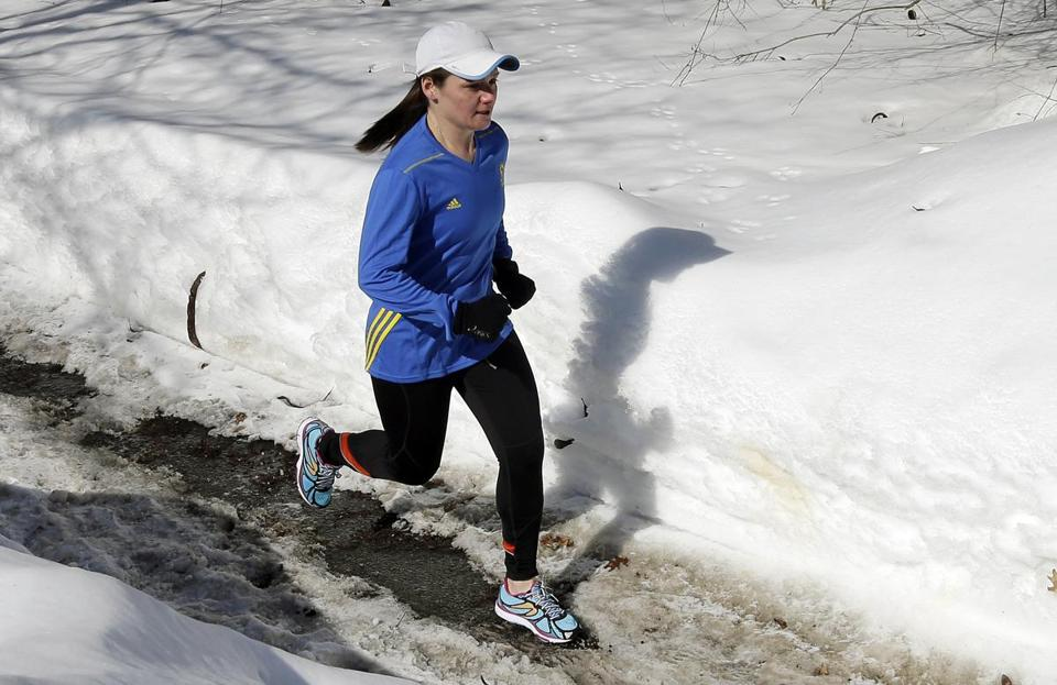 Becca Pizzi trained for the 2015 Boston Marathon along Heartbreak Hill in Newton.