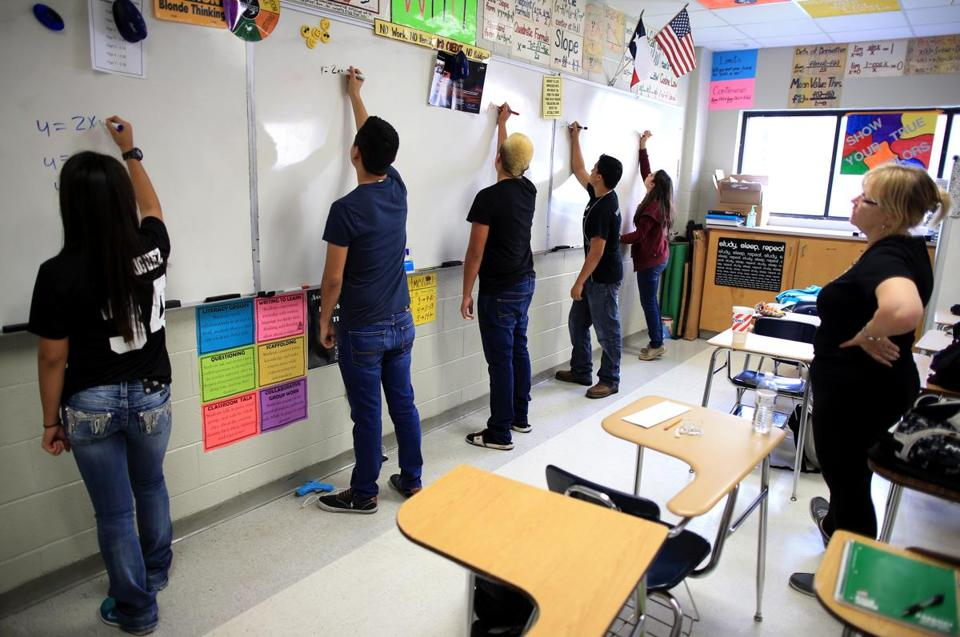 Teacher Marcia Ziegler (right) observed calculus students at PSJA Early College High School as they solved equations.