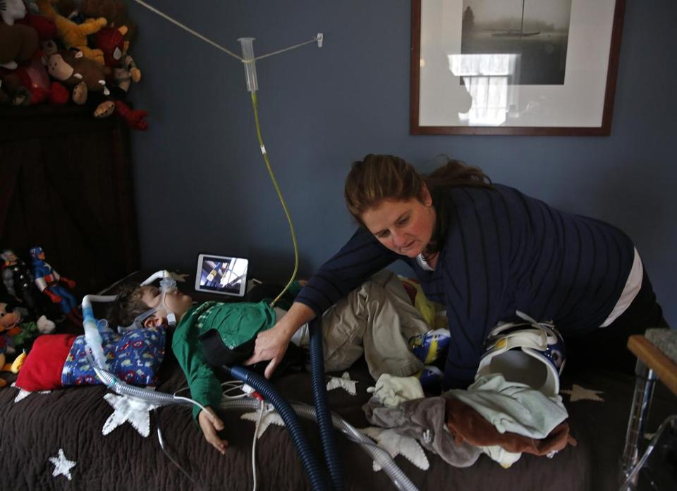 Courtney Davidopoulos reached to turn off a machine that vibrates Matthew, her 6- year-old son who suffers from spinal muscular atrophy.