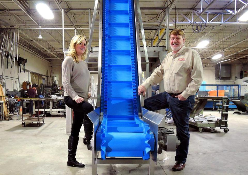 Alicia Gulczynski and her father, Paul, displayed a conveyor system built by Air Draulic in Randolph for a food service company.