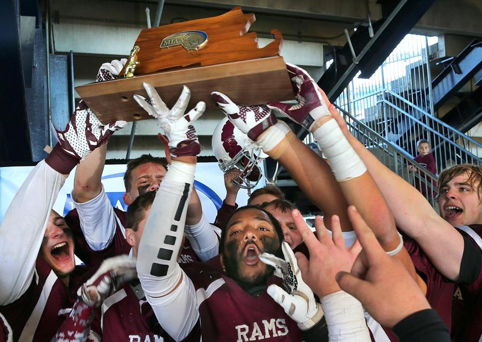 Northbridge's Keenan Quinama and teammates hold up the Division 5 Super Bowl trophy during the presentation ceremony.