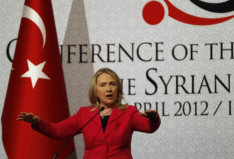 "Then-Secretary of State Hillary Clinton spoke at a ""Friends of Syria"" conference in Istanbul in 2012. Two Republican outside groups are joining forces to attack Clinton on her record in Syria."