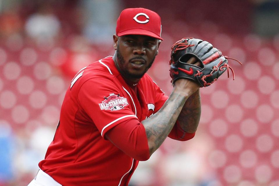 The Reds agreed to trade reliever Aroldis Chapman to the Dodgers Monday, but the deal has been put on hold.