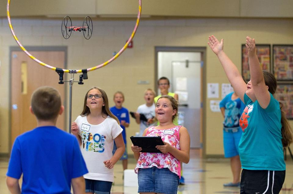 Fifth graders flew a drone through a hoop as part of an experiment in class at their elementary school in Gretna, Neb.