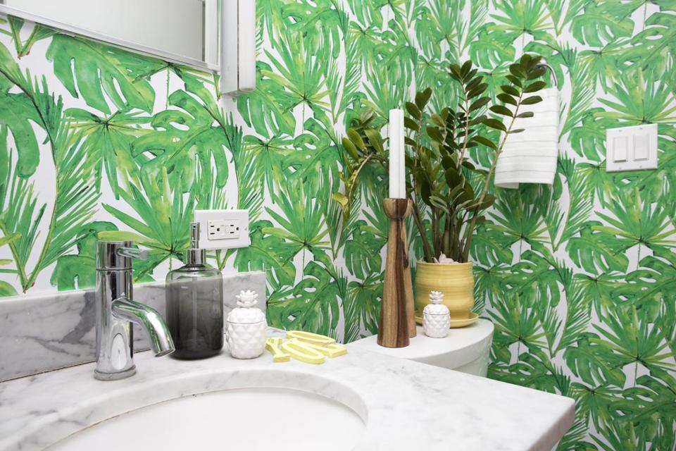 Shelly Lynch-Sparks chose a foliage wallpaper for a bathroom.