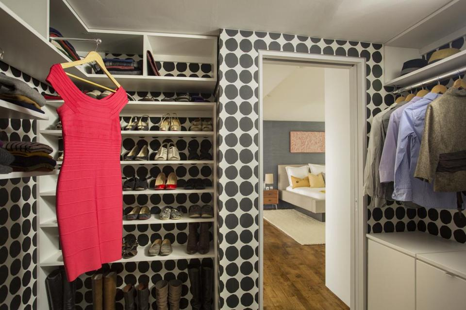 This South End closet is covered in a bold Marimekko pattern wallpaper.