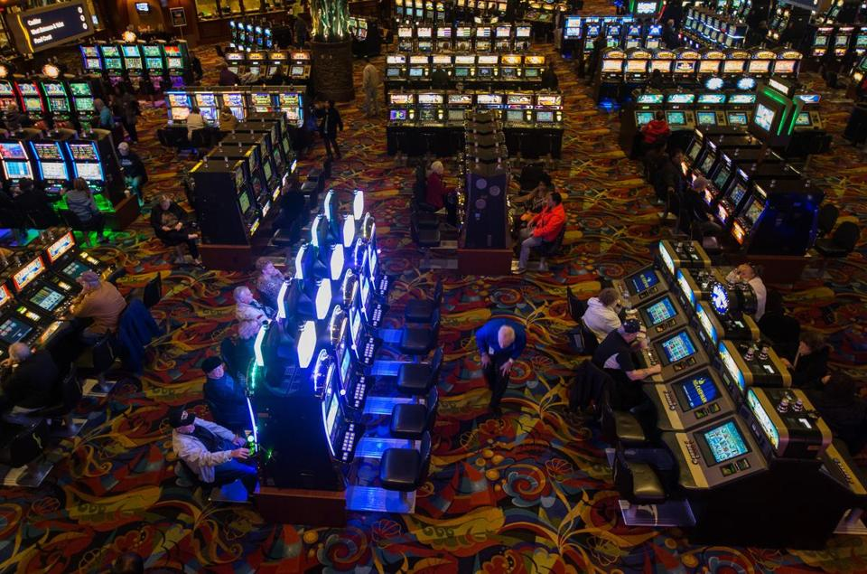 Gamblers played slot machines at Twin River Monday in Lincoln, R.I., on Monday. The casino has so far been able to thwart attempts by Plainridge Park to halt Massachusetts gamblers from heading to Rhode Island.