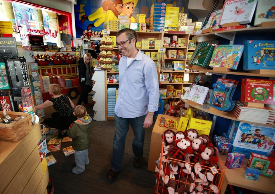 Adam Hirsch at the Curious George Store, the 21-year-old Harvard Square shop that he and his wife have owned for the past four years.