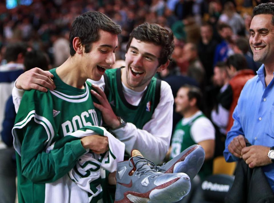 Aaron Miller (left) had in his hand the Nike sneakers Cavaliers star LeBron James wore against the Celtics Tuesday night.